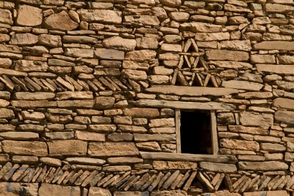 Detailed stonework graces the Amezray communal granary.
