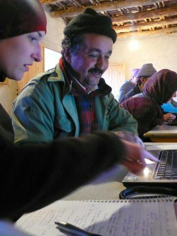 Teaching community leaders basic computer skills.