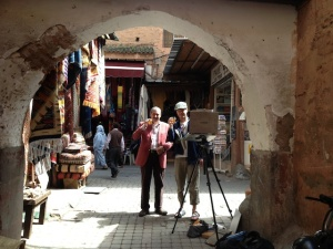 Photo of Aaron painting in the Marrakech medina